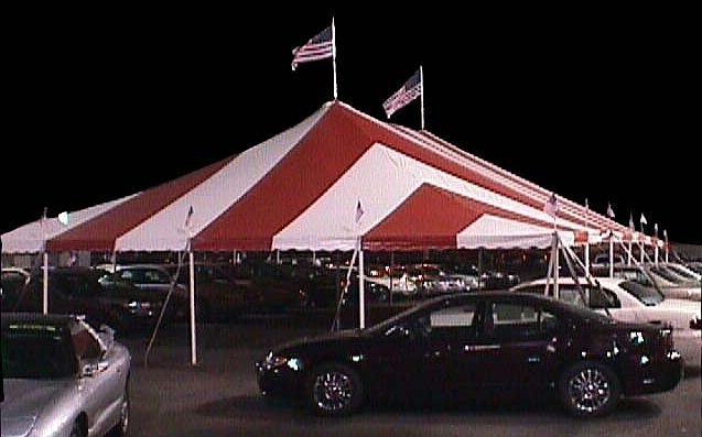 Peddler Rental Tent shown in typical installation with flags.